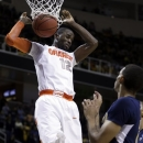 Syracuse forward Baye Moussa Keita, left, scores over California's Allen Crabbe in the second half of a third-round game in the NCAA college basketball tournament in San Jose, Calif., Saturday, March 23, 2013. Syracuse won 66-60. (AP Photo/Ben Margot)