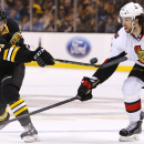 Boston Bruins' Craig Cunningham lets go with a shot past Ottawa Senators' Jared Cowen (2) during the second period of an NHL hockey game in Boston Saturday, Dec. 13, 2014 The Associated Press