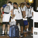 Real Madrid defender Alvaro Arbeloa, center, arrives at the team hotel with his teammates, Monday, Aug. 5, 2013 in Miami. Real Madrid will face Chelsea in the final of the International Champions Cup in Miami on Wednesday, Aug. 7, 2013. (AP Photo/Wilfredo Lee)