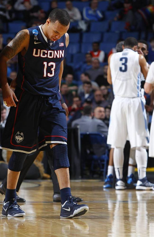 Connecticut's Shabazz Napier (13) is helped off the court after being hurt on a play during the second half of a third-round game against Villanova in the NCAA men's college basketball tournament in Buffalo, N.Y., Saturday, March 22, 2014