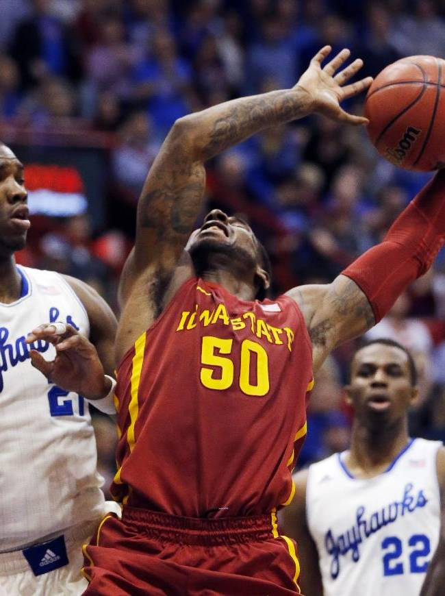 Iowa State guard DeAndre Kane (50) has the ball knocked away while covered by Kansas center Joel Embiid, left, during the second half of an NCAA college basketball game in Lawrence, Kan., Wednesday, Jan. 29, 2014. Kansas won 92-81