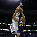 Utah Jazz small forward Richard Jefferson (24) is fouled as he goes to the basket against New Orleans Pelicans shooting guard Austin Rivers in the second half of an NBA basketball game in New Orleans, Wednesday, Nov. 20, 2013. The Pelicans won 105-98 The