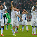 Manchester City's James Milner, second left, lifts a thumb after the Champions League group D soccer match between FC Bayern Munich and Manchester City, in Munich, southern Germany, Tuesday, Dec. 10, 2013. Manchester defeated Munich by 3-2