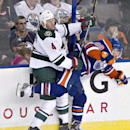 Minnesota Wild Clayton Stoner (4) checks Edmonton Oilers Sam Gagner (89) during third period NHL hockey action in Edmonton, Alberta, on Thursday Feb. 27, 2014 The Associated Press