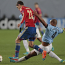 Manchester City's Vincent Kompany, right, challenges CSKA's Georgi Milanov during the Champions League Group E soccer match between CSKA Moscow and Manchester City at Arena Khimki stadium in Moscow, Russia, Tuesday Oct. 21, 2014
