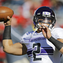 Northwestern quarterback Kain Colter (2) throws prior to an NCAA college football game against Nebraska in Lincoln, Neb., Saturday, Nov. 2, 2013. (AP Photo/Nati Harnik)