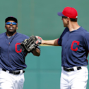 Cleveland Indians center fielder Michael Bourn, left, is congratulated by David Murphy after making a catch during an exhibition baseball game against the Chicago White Sox in Goodyear, Ariz., Tuesday, March 4, 2014 The Associated Press