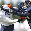 Chicago Bears wide receiver Eric Weems (14), right, works with cornerback Charles Tillman (33) during NFL football training camp at Olivet Nazarene University, Wednesday, July 30, 2014, in Bourbonnais, Ill The Associated Press