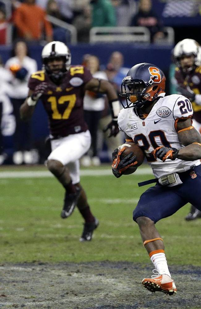 Syracuse wide receiver Brisly Estime (20) returns the ball as Minnesota's Antonio Johnson (11) and Damarius Travis (7) defend during the second half of the Texas Bowl NCAA college football game on Friday, Dec. 27, 2013, in Houston. Syracuse won 21-17