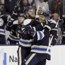 Columbus Blue Jackets' Cam Atkinson, right, celebrates his goal against the Ottawa Senators with teammate James Wisniewski during the second period of an NHL hockey game Tuesday, Oct. 28, 2014, in Columbus, Ohio The Associated Press
