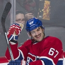 Montreal Canadiens' Max Pacioretty celebrates after scoring against the Pittsburgh Penguins during second-period NHL hockey game action in Montreal, Saturday, Nov. 23, 2013 The Associated Press