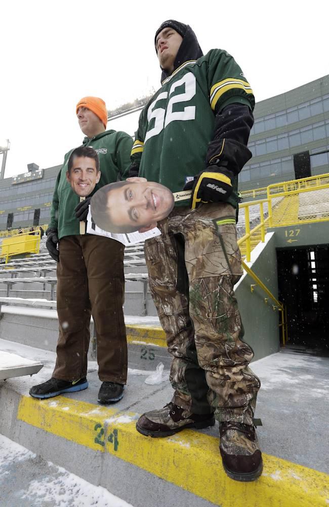 Brad Bauer, left, and Jake Hoernke arrive at Lambeau Field before an NFL football game between the Green Bay Packers and the Atlanta Falcons Sunday, Dec. 8, 2013, in Green Bay, Wis