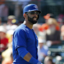Toronto Blue Jays' Jose Bautista walks back to the dugout after striking out during the third inning of an exhibition baseball game against the Baltimore Orioles in Sarasota, Fla., Saturday, March 1, 2014 The Associated Press