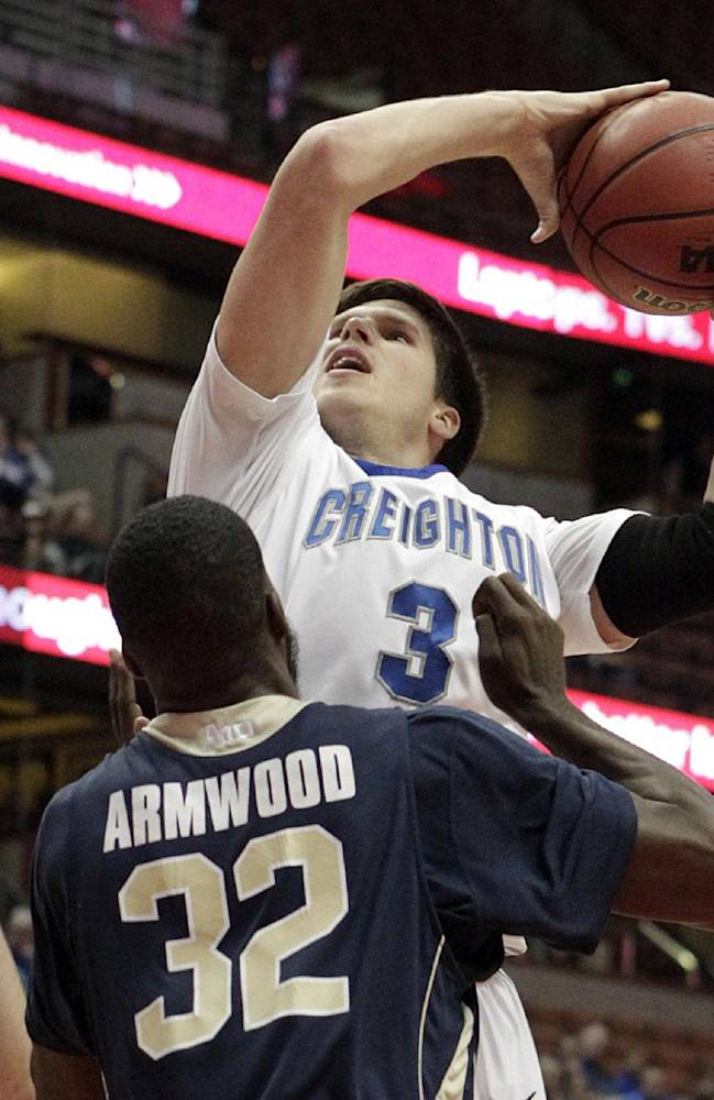 Creighton forward Doug McDermott (3) shoots over George Washington University forward Isaiah Armwood (32) in the first half of an NCAA men's college basketball game at the Wooden Legacy tournament in Anaheim, Calif., Sunday, Dec. 1, 2013