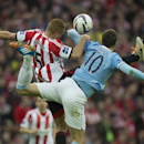 Manchester City's Edin Dzeko, right, fights for the ball against Sunderland's Wes Brown during the League Cup Final at Wembley Stadium, London, England, Sunday March 2, 2014