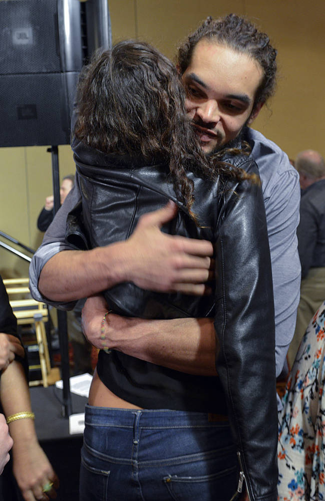 Chicago Bulls center Joakim Noah, second from right, embraces his sister Yelina Noah, center, as his mom, Cecilia Rodhe, second from left, stands near after Joakim Noah was awarded the NBA's Defensive Player of the Year honor, Monday, April 21, 2014, in Lincolnshire, Ill