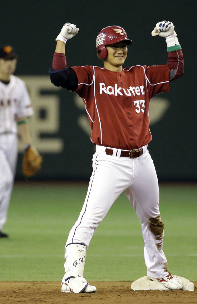 Rakuten Eagles' Ginji Akaminai celebrates at second after hitting a two-run double off Yomiuri Giants starter Toshiya Sugiuchi, in the second inning of Game 3 of baseball's Japan Series at Tokyo Dome in Tokyo, Tuesday, Oct. 29, 2013
