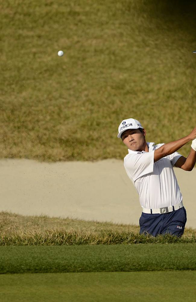 In this photo released by OneAsia, South Korea's Kang Soon-hoon plays a shot during the final round of the Korea Open golf tournament at Woo Jeong Hills Country Club near Cheonan, South Korea, Sunday, Oct. 20, 2013. Kang won the tournament