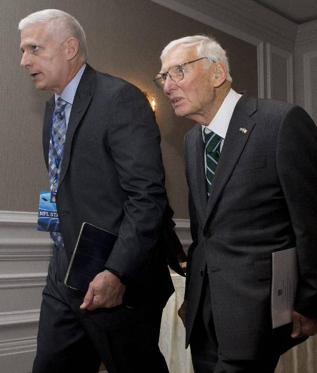 Pittsburgh Steelers football team owner Dan Rooney, right, walks with an NFL staff person as he arrives for the NFL owners fall meeting in Washington, Tuesday, Oct. 8, 2013