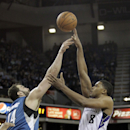 Sacramento Kings forward Rudy Gay, right, shoots over Minnesota Timberwolves center Nikola Pekovic, of Montenegro, during the fourth quarter of an NBA basketball game in Sacramento, Calif., Saturday, March 1, 2014. The Timberwolves won 108-97 The Associa