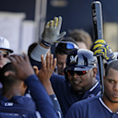 Milwaukee Brewers' Juan Francisco greeted by teammates after his solo home run during the fourth inning of a spring exhibition baseball game against the Seattle Mariners on Wednesday, March 19, 2014, in Peoria, Ariz The Associated Press