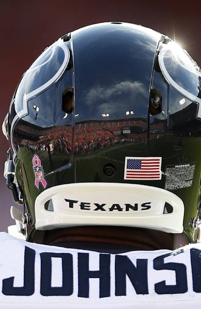 Candlestick Park is reflected in the helmet of Houston Texans wide receiver Andre Johnson before an NFL football game against the San Francisco 49ers in San Francisco, Sunday, Oct. 6, 2013