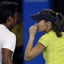 Martina Hingis of Switzerland, right, and Leander Paes of India talk between plays as they play Czech Republic's Andrea Hlavackova and Austria's Alexander Peya in their mixed doubles quarterfinal match at the Australian Open tennis championship in Melbourne, Australia, Wednesday, Jan. 28, 2015. (AP Photo/Vincent Thian)