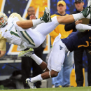 Baylor quarterback Bryce Petty (14) is tackled by West Virginia's Daryl Worley (7) during the first quarter of an NCAA college football game in Morgantown, W.Va., Saturday, Oct. 18, 2014. (AP Photo/Chris Jackson)