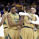 Notre Dame players celebrate after an 81-70 win over Wichita State in a college basketball game in the NCAA men's tournament regional semifinals, Thursday, March 26, 2015, in Cleveland. (AP Photo/Tony Dejak)
