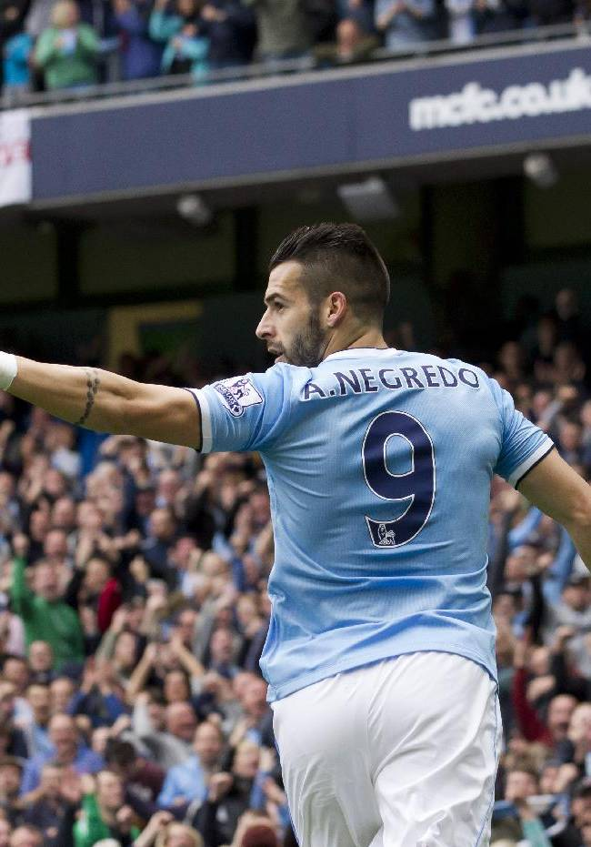 Manchester City's Alvaro Negredo celebrates after scoring against Everton during their English Premier League soccer match at the Etihad Stadium, Manchester, England, Saturday Oct. 5, 2013