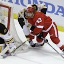 Boston Bruins goalie Tuukka Rask (40) of Finland stops a shot by Detroit Red Wings center Darren Helm (43) during the second period of Game 4 of a first-round NHL hockey playoff series in Detroit, Thursday, April 24, 2014 The Associated Press