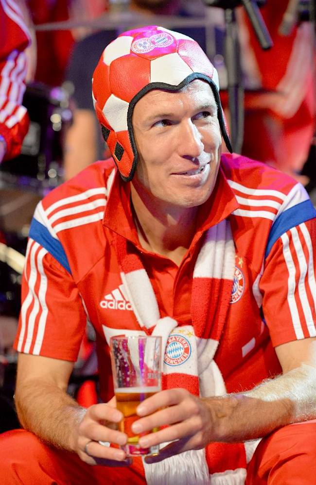 In this picture taken Saturday May 17, 2014  Bayern Munich  player Arjen Robben  enjoys a beer during celebrations after the team won the German soccer cup final against Borussia Dortmund, in Berlin