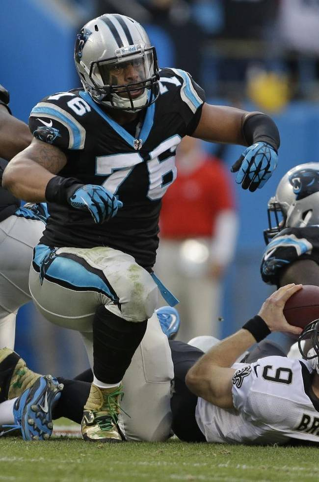 In this Dec. 22, 2013, file photo, New Orleans Saints' Drew Brees (9) is sacked by Carolina Panthers' Greg Hardy (76), Kawann Short (99) and Mario Addison (97) in the first half of an NFL football game in Charlotte, N.C. After leading the league in sacks last season, some Carolina Panthers think they have a shot to set the NFL's record for sacks in a season which is held by the 1984 Chicago Bears _ a team their head coach Ron Rivera played on