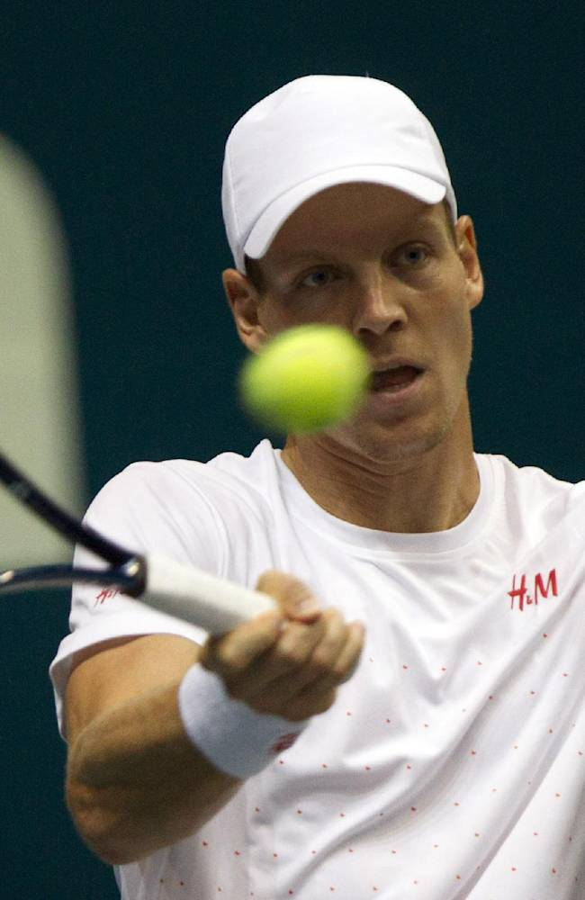 Tomas Berdych of the Czech Republic return a shot against Milos Raonic of Canada during their final match of the Thailand Open tennis tournament in Bangkok, Thailand Sunday, Sept. 29, 2013. Raonic won the match 7-6, 6-3
