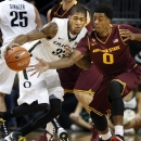 Oregon's Carlos Emory, left, collides with Arizona State's Carrick Felix during the first half of an NCAA college basketball game in Eugene, Ore. Sunday Jan. 13, 2013. (AP Photo/Chris Pietsch)