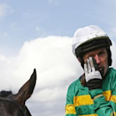 A.P McCoy wipes away a tear after finishing third in the Handicap Hurdle Race, his last ever competitive race. Reuters / Eddie Keogh
