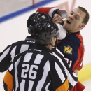 Game officials pull Florida Panthers' Krys Barch (21) away from Montreal Canadiens' George Parros, not shown, after a fight during the first period of an NHL hockey game in Sunrise, Fla., Saturday, March 29, 2014 The Associated Press