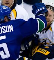 Vancouver Canucks' Brad Richardson, left, roughs up Nashville Predators' Ryan Ellis during the third period of an NHL hockey game in Vancouver, British Columbia, on Wednesday, March 19, 2014. (AP Photo/The Canadian Press, Darryl Dyck)