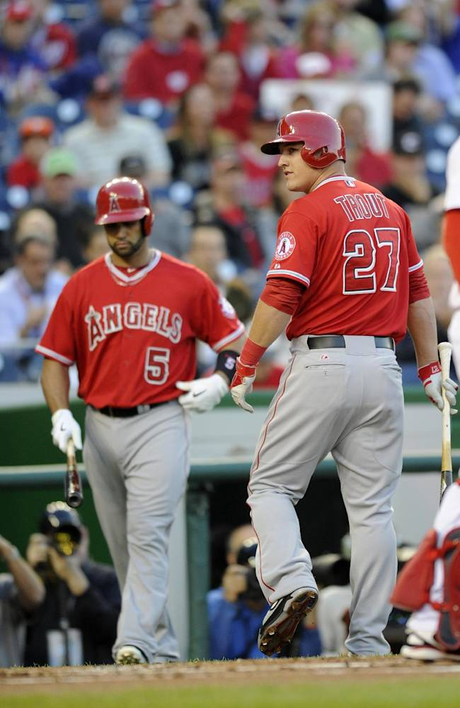 Los Angeles Angels center fielder Mike Trout (27) looks back after he struck out during the first inning of a baseball game against the Washington Nationals, Monday, April 21, 2014, in Washington. Also seen is Albert Pujols (5)