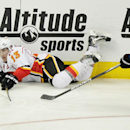 Calgary Flames' Mike Cammalleri (13) slides across the ice with Colorado Avalanches' Jamie McGinn in tow during the third period of an NHL hockey game on Friday, Nov. 8, 2013, in Denver. The Avalanche won 4-2 The Associated Press