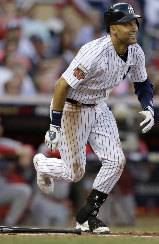 American League shortstop Derek Jeter, of the New York Yankees, singles during the third inning of the MLB All-Star baseball game, Tuesday, July 15, 2014, in Minneapolis. (AP Photo/Jeff Roberson)