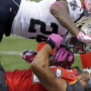 New Orleans Saints cornerback Corey White (24) hits Tampa Bay Buccaneers wide receiver Vincent Jackson (83) in the second half of an NFL football game in New Orleans, Sunday, Oct. 5, 2014 The Associated Press