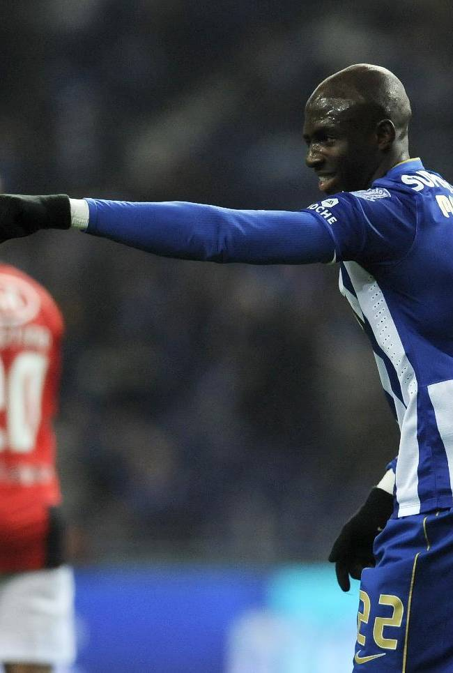 FC Porto's Eliaquim Mangala, from France, celebrates after scoring the opening goal against Olhanense in a Portuguese League soccer match at the Dragao Stadium in Porto, Portugal, Friday, Dec. 20, 2013