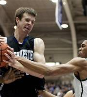 Northwestern forward John Shurna, left, rips a rebound from Michigan State guard Brandon Kearney during the first half of a college basketball game on Jan 14, 2012 in Evanston, Ill.  (AP Photo/Brian Kersey)