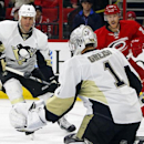 Carolina Hurricanes' Riley Nash (20) has his shot blocked by Pittsburgh Penguins goalie Thomas Greiss (1) as Rob Scuderi (4) gives chase during the second period of an NHL hockey game in Raleigh, N.C., Saturday, Nov. 29, 2014 The Associated Press