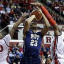 Pittsburgh's Trey Zeigler (23) has his shot blocked by Rutgers defender Wally Judge (33) as Rutgers' Mike Poole (10) helps out defending during the first half of an NCAA college basketball game, Saturday, Jan. 5, 2013, in Piscataway, N.J. (AP Photo/Mel Evans)