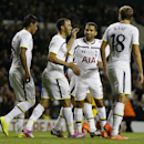 Tottenham's Andros Townsend, second left, celebrates scoring a goal from a penalty during the second leg Europa League qualifying soccer match between Tottenham Hotspur and AEL Limassol at White Hart Lane stadium in London Thursday, Aug. 28, 2014