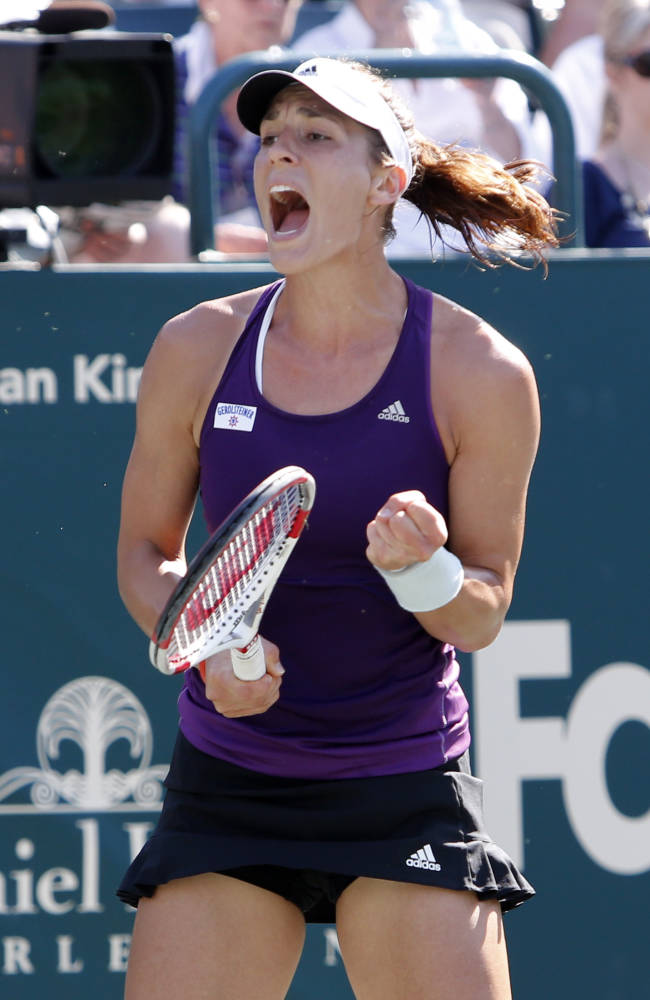 Andrea Petkovic, of Germany, reacts to Lucie Safarova, of the Czech Republic, during the Family Circle Cup tennis tournament in Charleston, S.C., Friday, April 4, 2014