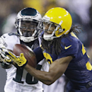 Green Bay Packers' Tramon Williams intercepts a pass in front of Philadelphia Eagles' Jeremy Maclin during the second half of an NFL football game Sunday, Nov. 16, 2014, in Green Bay, Wis The Associated Press