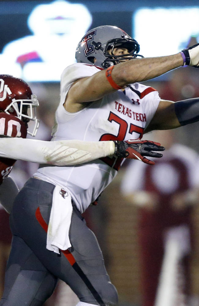 Oklahoma defensive back Quentin Hayes (10) defends as Texas Tech tight end Jace Amaro (22) reaches for a pass in the fourth quarter of an NCAA college football game in Norman, Okla., Saturday, Oct. 26, 2013. Oklahoma won 38-30